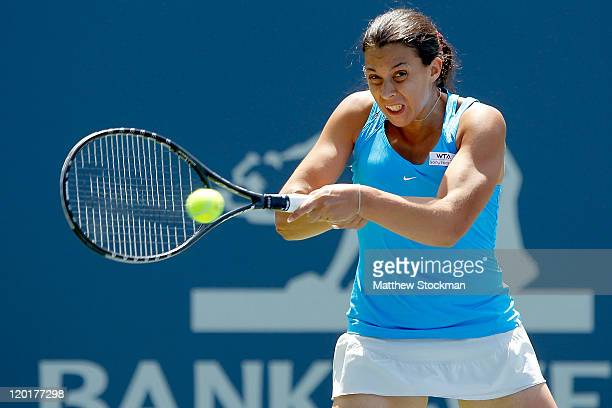 Marion Bartoli of France returns a shot to Serena Williams during the final of the Bank of the West Classic at the Taube Family Tennis Stadium on...