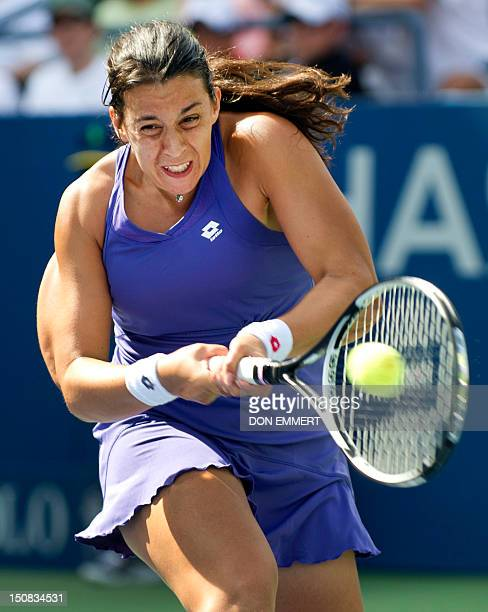 Marion Bartoli of France returns to Jamie Hampton of the US during their women's first round match at the 2012 US Open tennis tournament on August...