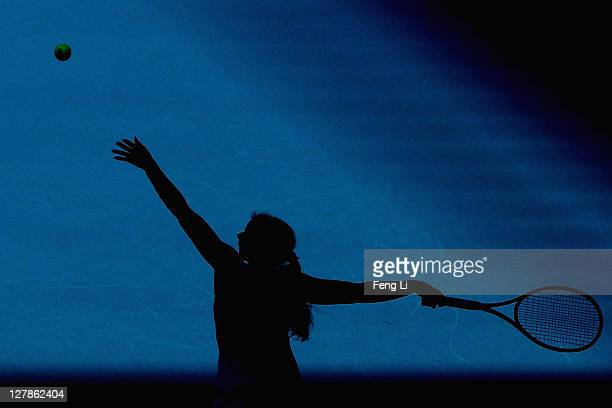 Marion Bartoli of France serves a shot to Iveta Benesova of the Czech Republic during day two of the China Open at the National Tennis Center on...