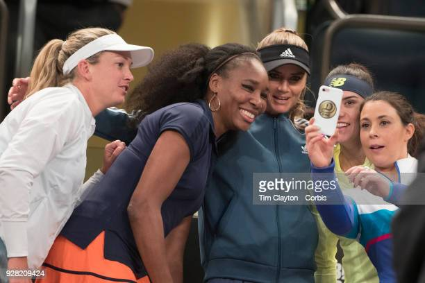 Marion Bartoli of France takes a group photograph with Coco Vandeweghe of the United States Venus Williams of the United States Daniela Hantuchová of...