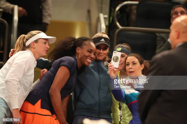 Marion Bartoli of France takes a group photograph with Coco Vandeweghe of the United States Venus Williams of the United States Daniela Hantuchova of...