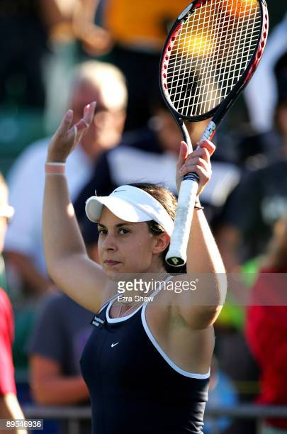 Marion Bartoli of France waves to the crowd after beating Jelena Jankovic of Serbia in their quarterfinal match on Day 5 of the Bank of the West...