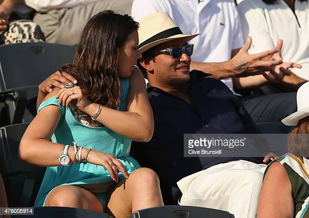 Marion Bartoli watches the Men's Semi Final match between Novak Djokovic of Serbia and Andy Murray of Great Britain on day thirteen of the 2015...