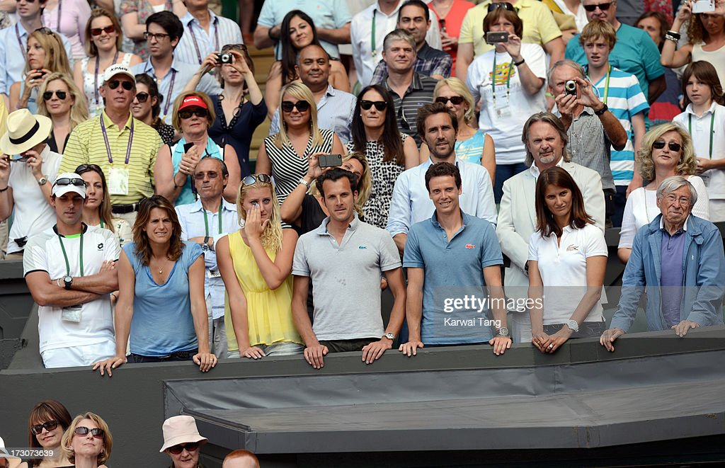 Marion Bartoli's friends and family watch her being presented with the winners trophy after beating Sabine Lisicki in the Ladies Singles Final on Day 12 of the Wimbledon Lawn Tennis Championships at the All England Lawn Tennis and Croquet Club on July 6, 2013 in London, England.