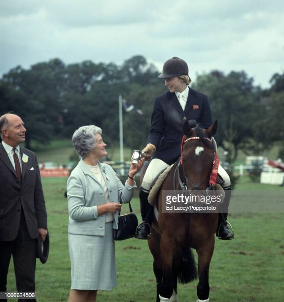 Marion Coakes aboard Stroller winners of the Wills Grand Stakes Fault Cut receives her trophy at Hickstead on 18th August 1968