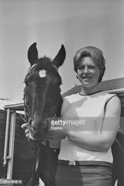 Marion Coakes British show jumper poses with one of her horses 9th August 1965