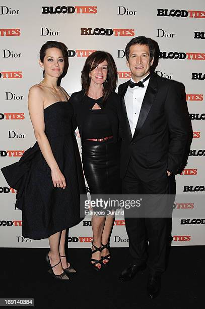 Marion Cotillard Albane Cleret and Guillaume Canet attend the 'Blood Ties' cocktail and party hosted by Dior at Club by Albane in Bulgari Rooftop on...