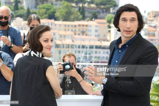 """Marion Cotillard and Adam Driver attend the """"Annette"""" photocall during the 74th annual Cannes Film Festival on July 06, 2021 in Cannes, France."""