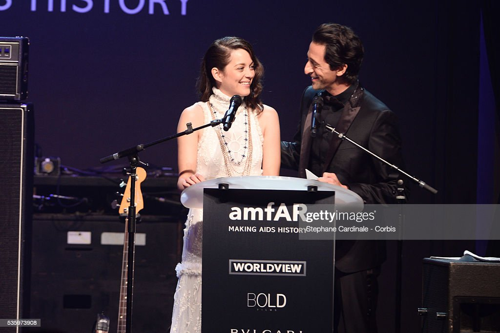Marion Cotillard and Adrian Brody at the amfAR's 21st Cinema Against AIDS Gala at Hotel du Cap-Eden-Roc during the 67th Cannes Film Festival