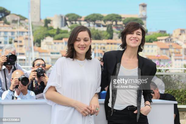 Marion Cotillard and Charlotte Gainsbourg attend the 'Ismael's Ghosts ' photocall during the 70th annual Cannes Film Festival at Palais des Festivals...