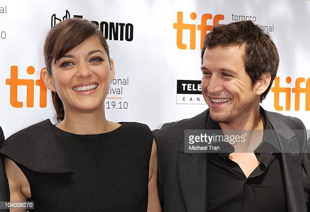 Marion Cotillard and Guillaume Canet arrive at the 'Little White Lies' premiere during the 2010 Toronto International Film Festival held at Roy...