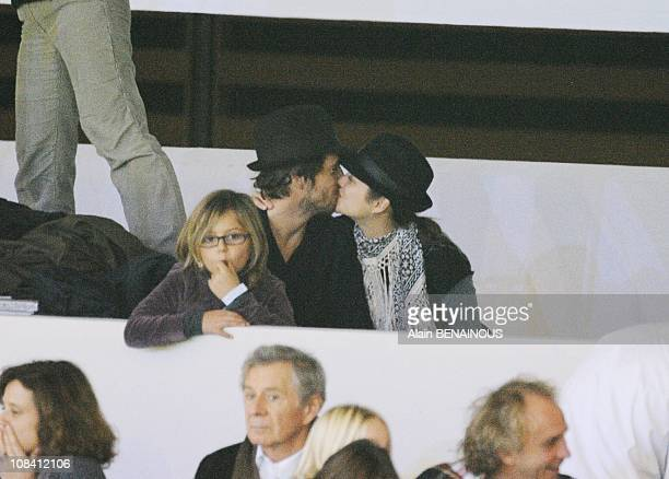 Marion Cotillard and Guillaume Canet attend the Gucci Master International jumping in Villepinte France on December 13th 2009