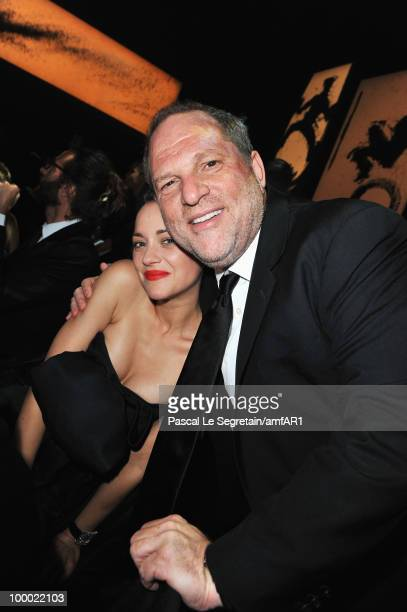 Marion Cotillard and Harvey Weinstein attends amfAR's Cinema Against AIDS 2010 benefit gala dinner at the Hotel du Cap on May 20 2010 in Antibes...