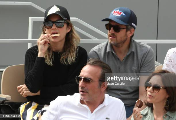 Marion Cotillard and husband Guillaume Canet attend the men's final during day 15 of the 2019 French Open at Roland Garros stadium on June 9 2019 in...