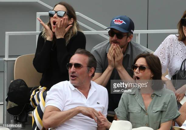 Marion Cotillard and husband Guillaume Canet below Jean Dujardin and wife Nathalie Pechalat attend the men's final during day 15 of the 2019 French...