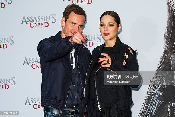 Marion Cotillard and Michael Fassbender attend the 'Assassin's Creed' Berlin Photocall at Cafe Moskau on December 1 2016 in Berlin Germany