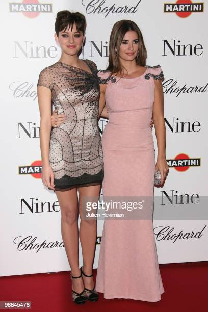 Marion Cotillard and Penelope Cruz attend the premiere of 'Nine' at Cinema Gaumont Marignan on February 18, 2010 in Paris, France.
