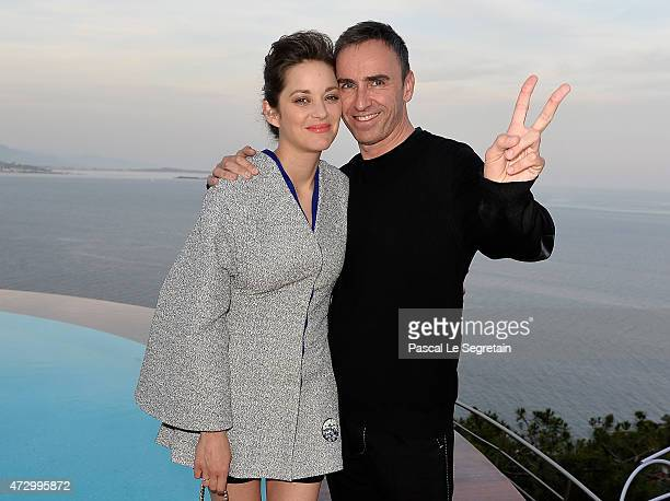 Marion Cotillard and Raf Simons attend the Dior Croisiere 2016 at Palais Bulle on May 11 2015 in Theoule sur Mer France
