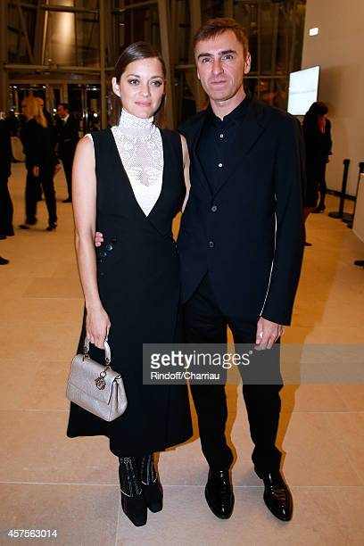 Marion Cotillard and Raf Simons attend the Foundation Louis Vuitton Opening at Foundation Louis Vuitton on October 20 2014 in BoulogneBillancourt...