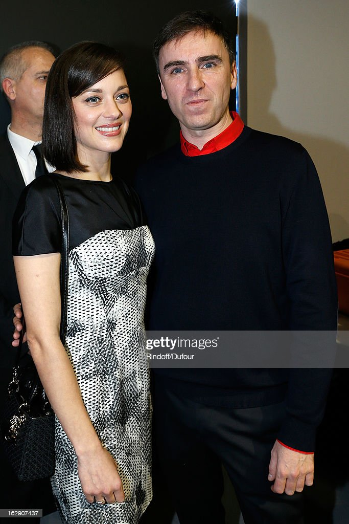 Marion Cotillard and Raf Simons attends the Christian Dior Fall/Winter 2013 Ready-to-Wear show as part of Paris Fashion Week on March 1, 2013 in Paris, France.