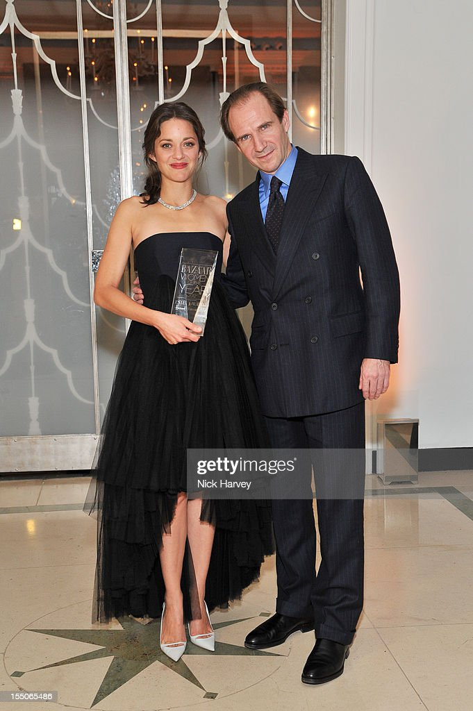 Marion Cotillard and Ralph Fiennes attend the Harper's Bazaar Woman of the Year Awards at Claridge's Hotel on October 31, 2012 in London, England.