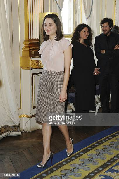 Marion Cotillard and Tim Burton awarded 'The Order of Arts and Letters' at French Culture Minister Guillaume Canet in Paris France on March 15th 2010