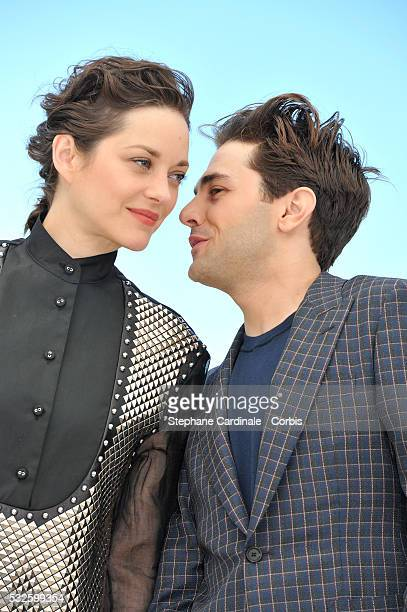 """Marion Cotillard and Xavier Dolan attend the """"It's Only The End Of The World """" Photocall during the 69th annual Cannes Film Festival at the Palais..."""
