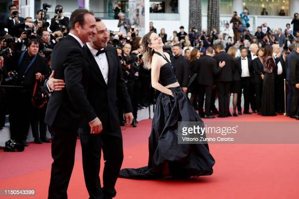 Marion Cotillard Gilles Lellouche and Jean Dujardin attend the screening of La Belle Epoque during the 72nd annual Cannes Film Festival on May 20...