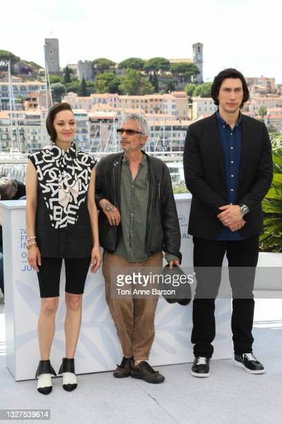 """Marion Cotillard, Leos Carax and Adam Driver attend the """"Annette"""" photocall during the 74th annual Cannes Film Festival on July 06, 2021 in Cannes,..."""