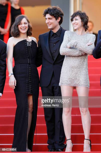 Marion Cotillard Louis Garrel and Charlotte Gainsbourg attend the 'Ismael's Ghosts ' screening and Opening Gala during the 70th annual Cannes Film...