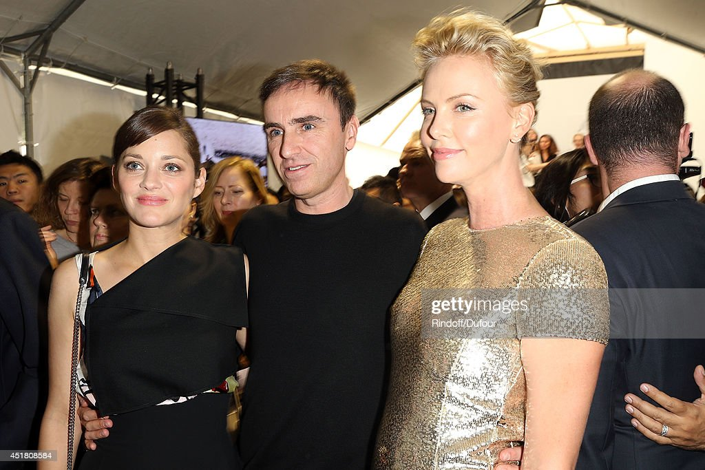 Marion Cotillard, Raf Simons and Charlize Theron attend in backstage the Christian Dior show as part of Paris Fashion Week - Haute Couture Fall/Winter 2014-2015 at Muse Rodin on July 7, 2014 in Paris, France.