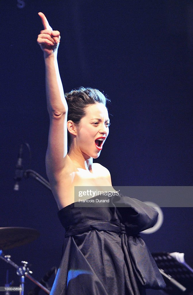 Marion Cotillard speaks during amfAR's Cinema Against AIDS 2010 benefit gala at the Hotel du Cap on May 20, 2010 in Antibes, France.