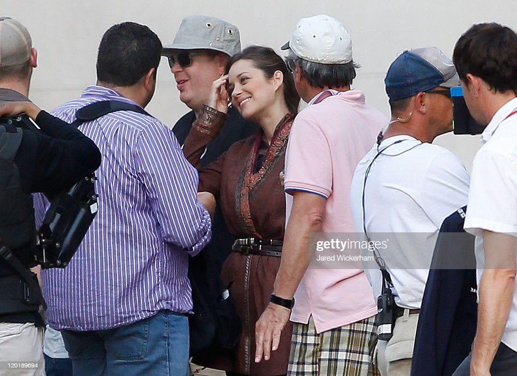 Marion Cotillard talks to crew members before a scene during filming of 'Batman: Dark Knight Rises' at the Mellon Institute building in the Oakland neighborhood of Pittsburgh, Pennsylvania on July 31, 2011.