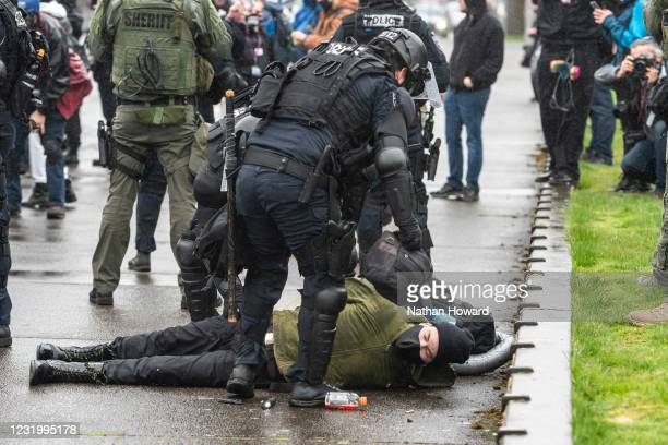 Marion Country Sheriff's deputies and Oregon State Troopers arrest a protester on March 28, 2021 in Salem, Oregon. The protesters clashed with...