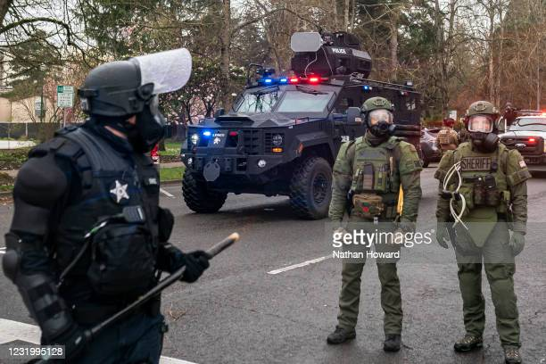 Marion Country Sheriff's deputies and Oregon State Troopers disperse a crowd of protesters on March 28, 2021 in Salem, Oregon. The protesters clashed...