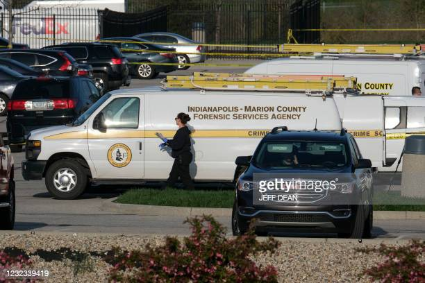 Marion County Forensic Services vehicles are parked at the site of a mass shooting at a FedEx facility in Indianapolis, Indiana on April 16, 2021. -...