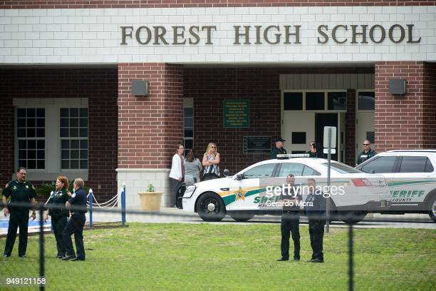 Marion County Police officers stand in front of Forest High School after a school shooting on April 20 2018 in Ocala Florida It was reported that a...