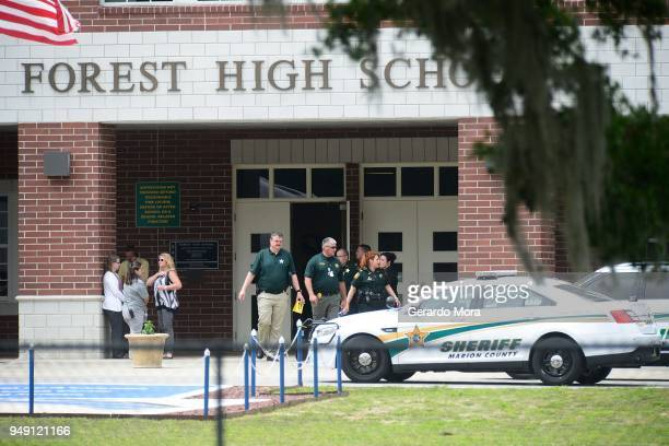 Marion County Police officers walk out Forest High School after a school shooting on April 20 2018 in Ocala Florida It was reported that a former...