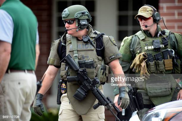 Marion County Sheriffs officers walk out Forest High School after a school shooting on April 20 2018 in Ocala Florida It was reported that a former...