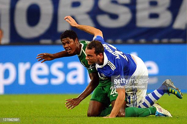 Marion de Jesus of Haifa and Christoph Metzelder of Schalke lie on the pitch during the UEFA Europa League group J match between FC Schalke 04 and...
