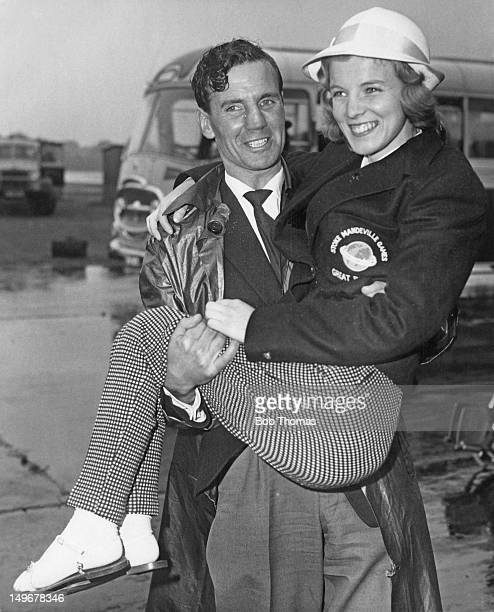 Marion Edwards a British contestant in the table tennis event being carried to her aircraft at London Airport 16th September 1960 She is en route to...