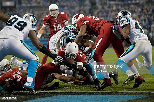 Marion Grice of the Arizona Cardinals dives into the endzone for a touchdown during their NFC Wild Card Playoff game against the Carolina Panthers at...