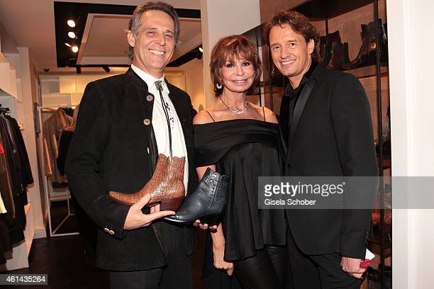 Marion Heinrich shoe designer Pedro Munoz founder of Stallion Boots and the executive director of the Marion Heinrich store pose during MaryKate...