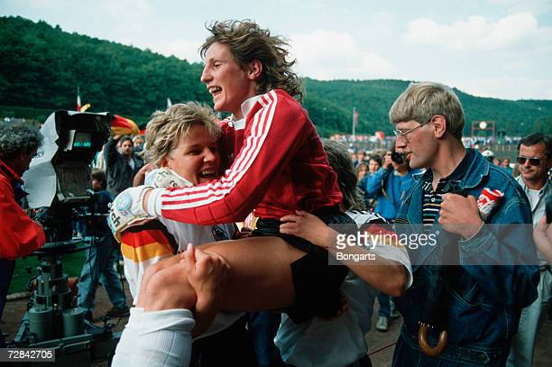 Marion Isbert of Germany celebrates with teammate Doris Fitschen after winning the UEFA Women's Euro 1989 final between Germany and Italy on July 2...