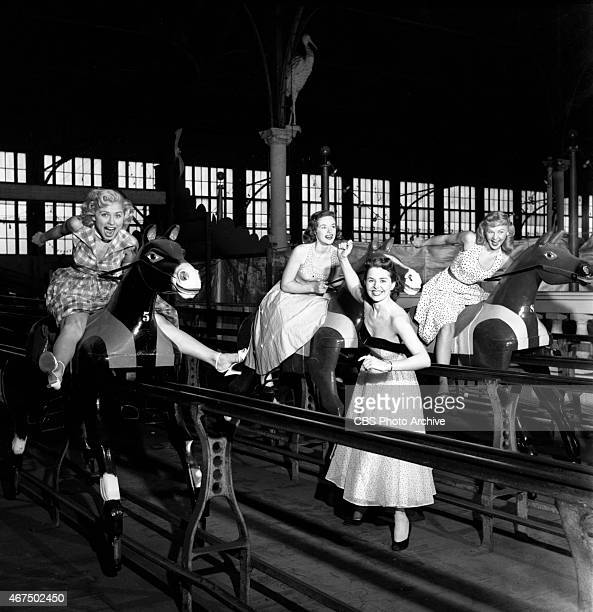 Marion James watches as Cindy Robbins Pat Conway and Connie Mavis ride the Steeplechase Horse Ride Steeplechase Park Image dated May 11 1953