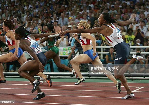 Marion Jones and Lauryn Williams of USA fumble the baton as they compete in the women's 4 x 100 metre relay on August 27 2004 during the Athens 2004...