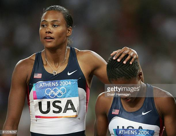 Marion Jones and Lauryn Williams of USA walk dejected after the women's 4 x 100 metre relay on August 27 2004 during the Athens 2004 Summer Olympic...