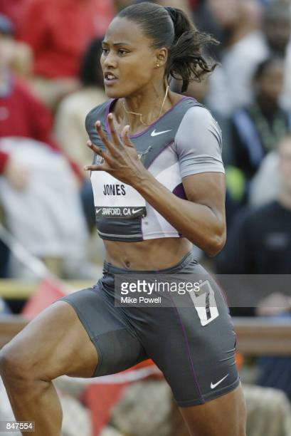 Marion Jones competes in the women's 100 meter dash during the 2002 USA Outdoor Track & Field Championships on June 21, 2002 at Stanford University...
