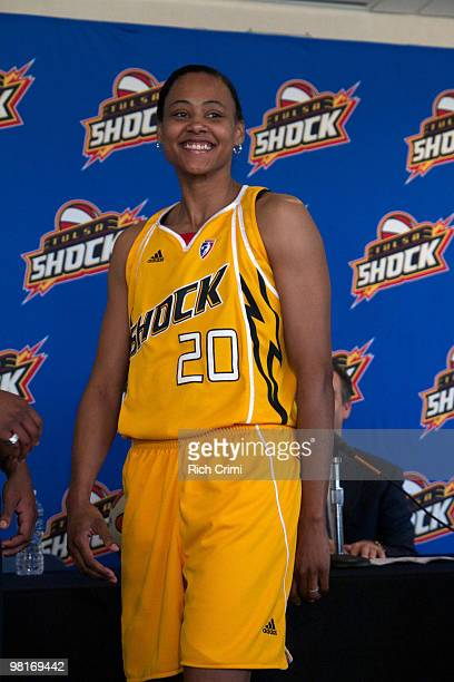 Marion Jones models the home uniform as the Tulsa Shock unveil their Jersey and Warren Clinic Orthopedic Surgery and Sports Medicine are named...
