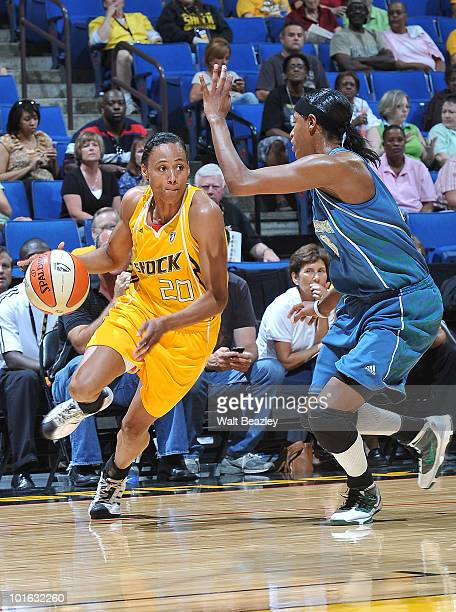 Marion Jones of the Tulsa Shock moves the ball into the paint against Rashanda McCants of the Minnesota Lynx at the Bok Center June 4 2010 in Tulsa...